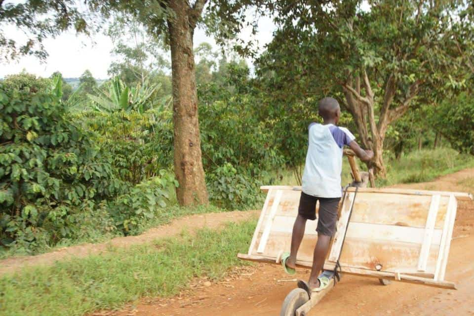 Ugandan scooter going to market