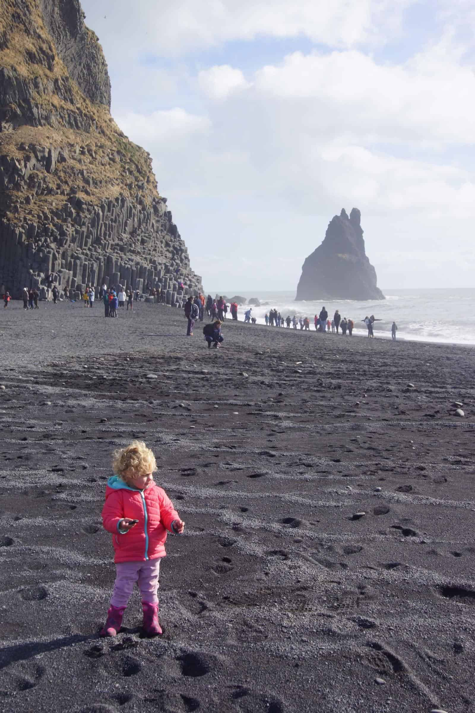Toddler on Black Beach Iceland - iceland with a baby or toddler